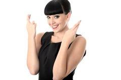 Positiv hoppfull längtansfull lycklig kvinna med korsade fingrar Arkivbilder