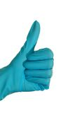 Positive. Blue gloved hand. Thumbs up Royalty Free Stock Photo