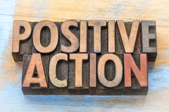 Positive action - word abstract in wood type. Positive action - word abstract in vintage letterpress printing blocks Stock Photo