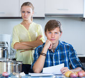 Positive adult spouses filling forms Stock Photo