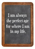 Positive affirmation words. I am always the perfect age for where I am in my life - positive affirmation words on a vintage slate blackboard stock images