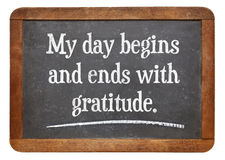 Positive affirmation words. My day begins and ends with gratitude - positive affirmation words on a vintage slate blackboard stock photos