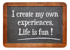 Positive affitrmation words. I create my own experiences. Life is fun! Positive affirmation words on a vintage slate blackboard stock image