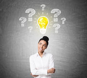 Positive African American girl and bulb questions Stock Photo