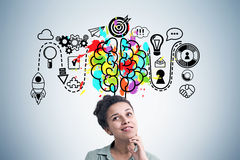 Positive African American girl and business brain Stock Images
