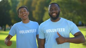 Positive afro-american males showing thumbs up, nature preservation volunteering stock video