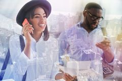 Positive afro american youth talking on phone. Always in touch. Positive smiling african american women talking on phone and standing with a handsome guy while Royalty Free Stock Photo