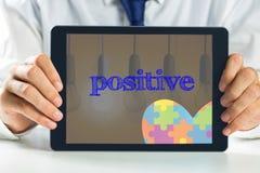 Positive against second light bulb lighting Stock Images