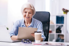 Positive aged businesswoman creating the project in the office royalty free stock photo