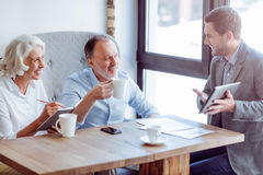 Positive aged couple meeting with sales manager Royalty Free Stock Image