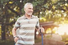 Positive aged man enjoying physical exercise royalty free stock image