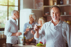 Positive aged man making a toast Stock Photography