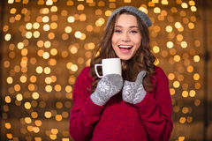 Free Positive Amusing Girl Drinking Coffee And Showing Thumbs Up Stock Photography - 63548802