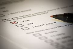 Positive answer in questionnaire. With red pen Royalty Free Stock Images