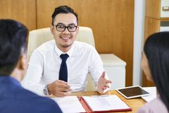 Estate agent explaining contract details stock photos