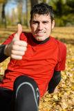 Positive athlete. Positive hispanic sportsman with thumbs up smiling. Autumn park scene outside Stock Photography