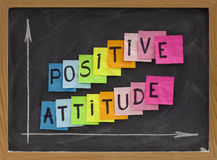 Positive attitude. Concept - colorful sticky notes, handwriting and white chalk drawing on blackboard stock photo