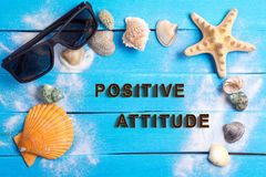 Positive attitude with summer settings concept. Positive attitude on Beach Accessories With Few Marine Items On Blue Wooden Plank , Summer concept stock photo