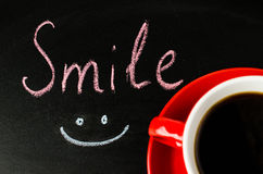 Positive attitude concept. Cup of Coffee. Inscription Smile. Positive attitude concept. Cup of Coffee on a Dark Background. Inscription Smile. Toned Image Royalty Free Stock Image