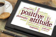 Positive attitude or mindset. Positive attitude word cloud on a digital tablet with a cup of coffee Stock Photos