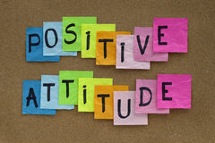 Positive attitude reminder. Positive attitude concept - colorful sticky notes reminder on cork bulletin board Stock Photography