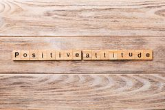 Positive Attitude word written on wood block. Positive Attitude text on wooden table for your desing, concept.  royalty free stock image