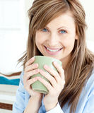 Positive attractive businesswoman holding a cup Royalty Free Stock Image