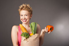 Positive attractive girl with useful food Stock Photos