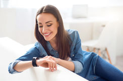 Positive attractive woman resting on the couch stock images