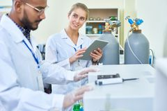 Smiling female assistant asking doctor of medicine stock photo