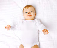 Positive baby lying on the bed Royalty Free Stock Image