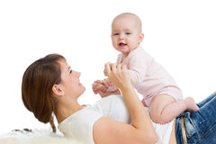 Positive baby and mom. Young mother plays with her little daughter. Stock Photo