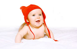 Positive baby in red hat Stock Image