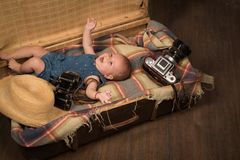 Positive baby. Small girl in suitcase. Traveling and adventure. Portrait of happy little child. Sweet little baby. New. Life and birth. Childhood happiness stock images
