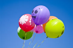 Positive balls. The Festive air balls on background blue spring sky Stock Photos