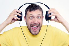 Positive bearded happy man with headphones Royalty Free Stock Image