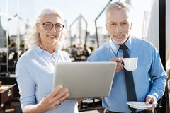 Positive bearded man standing near his partner Stock Image