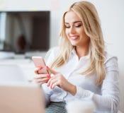 Positive beautiful business woman  using smart phone Stock Photography
