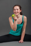 Positive beautiful woman eating an apple. Positive beautiful woman eating green apple Stock Image