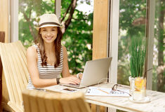 Positive beautiful woman using laptop Stock Photos