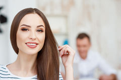 Positive beautiful woman working in the office Royalty Free Stock Image
