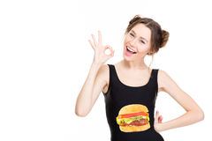 Positive beautiful young woman showing ok gesture Royalty Free Stock Photography