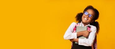 Free Positive Black Schoolgirl Embracing Book, Studio Shot, Panorama Stock Images - 158631524