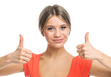 Positive blond girl with thumbs up Stock Photos