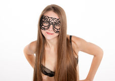 Positive blonde woman in lingerie and mask Royalty Free Stock Images