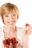 Positive blonde woman with strawberry Stock Image