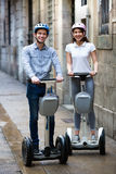 Positive boy and girl posing on segways in vacation Royalty Free Stock Photos