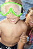 Positive boy and girl sre in the swimming pool Royalty Free Stock Image
