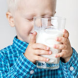 Boy with a glass of milk. Stock Image
