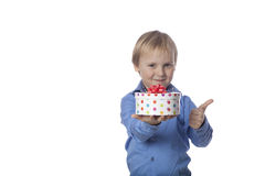 Positive boy holds present Stock Photo